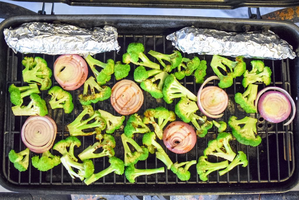 Grilled broccoli salad recipe ingredients on the grill
